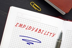 Conceptual photo about EMPLOYABILITY with handwritten text. Employabilityrefers to your ability to gain initial employment, maintain. employment, and obtain new employment if required