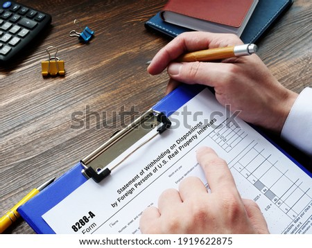 Conceptual photo about Form 8288-A Statement of Withholding on Dispositions by Foreign Persons of U.S. Real Property Interests with written phrase. Stock photo ©