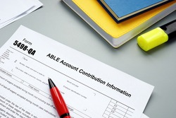 Conceptual photo about Form 5498-QA ABLE Account Contribution Information with handwritten text.