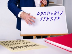 Conceptual photo about PROPERTY FINDER with handwritten text.