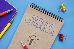 Conceptual photo about Roth Ira Withdrawal with handwritten phrase.