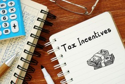 Conceptual photo about Tax Incentives with handwritten text.
