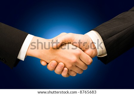 Conceptual photo of business people's hands making an agreement
