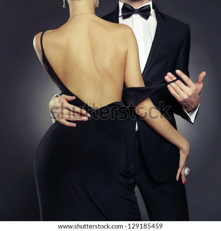 Conceptual photo of sexy elegant couple in the tender passion - stock photo