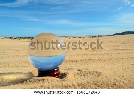 Conceptual Photo Picture of a Crystal Sphere in the dry desert