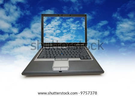 Conceptual photo with laptop and blue sky