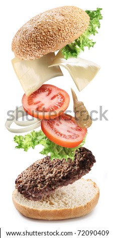 Conceptual photography - flying ingredients of hamburger. - stock photo