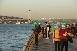 Conceptual photography - Istanbul, people walk of waterfront of Bosphorus face recognition technology concept illustration of big data and security in city