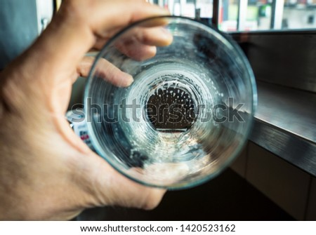 Conceptual picture of a empty beer glass in alcoholism idea and emptiness of drug abuse life
