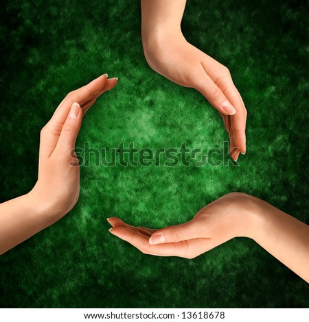 Conceptual recycling symbol made from hands on abstract grungy green background