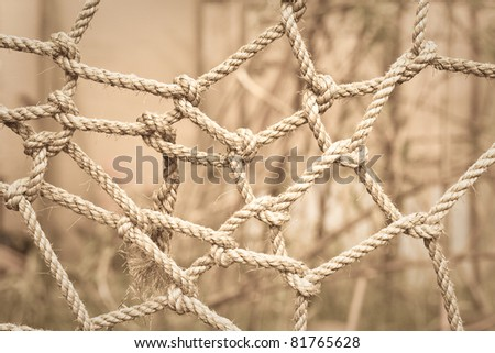 Conceptual sepia toned image of tangled rope - stock photo