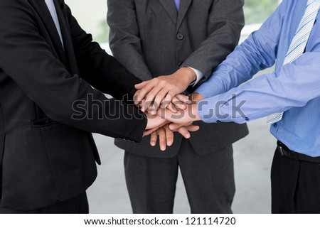 Conceptual shot of a business team forming bonds