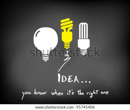 Conceptual sparking idea on black chalkboard with incandescent and fluorescent light bulbs
