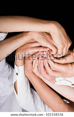 Conceptual symbol of multiracial human hands making a circle on white background