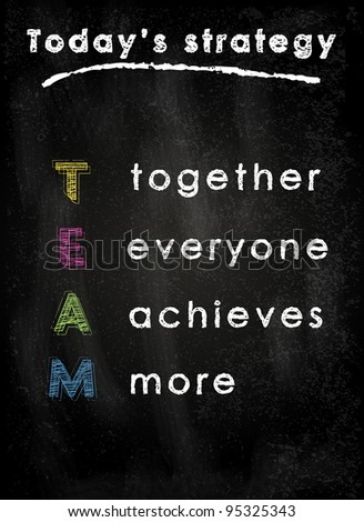 Conceptual TEAM acronym on black chalkboard (together, everyone, achieves, more)