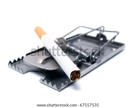 Conceptual view of smoking  presented with a cigarette as a bait on the mousetrap.