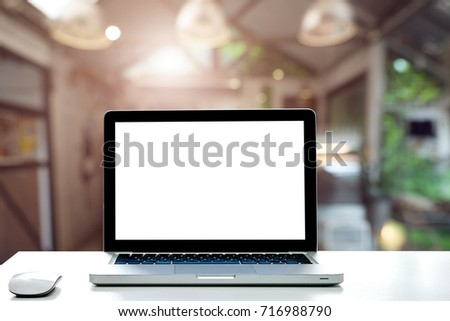 Conceptual workspace,Empty space desk white with on Laptop screen and wireless mouse at blurred background of Cafe.
