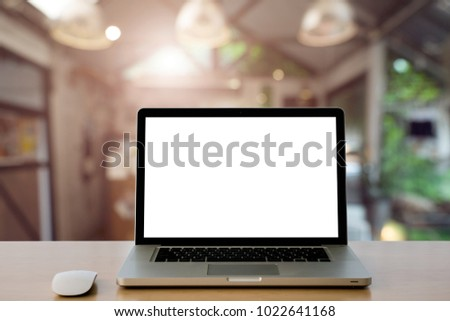 Conceptual workspace,Empty space Wooden Desk with on Laptop screen and wireless mouse in home blurred background at light bokeh.