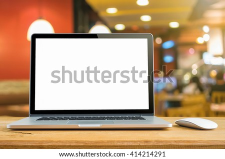 Conceptual workspace, Laptop computer with blank white screen on table, blurred background. #414214291