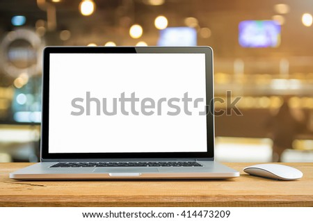 Conceptual workspace, Laptop computer with blank white screen on table, blurred background. #414473209