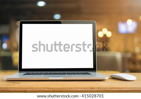 Conceptual workspace, Laptop computer with blank white screen on table, blurred background. #415028701