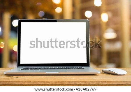 Conceptual workspace, Laptop computer with blank white screen on table, blurred background. #418482769