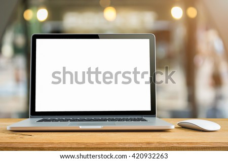Conceptual workspace, Laptop computer with blank white screen on table, blurred background. #420932263
