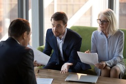 Concerned businesspeople argue with colleague or client dissatisfied with contract terms, mad worried businessman have dispute with business partner unhappy with agreement, claiming money back