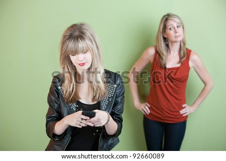 Concerned mom watches teen send text messages on phone