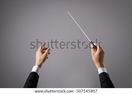 concert conductor hand with...