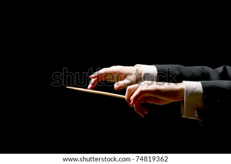 concert conductor hands with a...