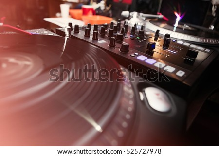 Concert dj turntable.Sound mixing controller & vinyl record player.Audio equipment for party disc jockey.Play music on professional technology for concert in nightclub
