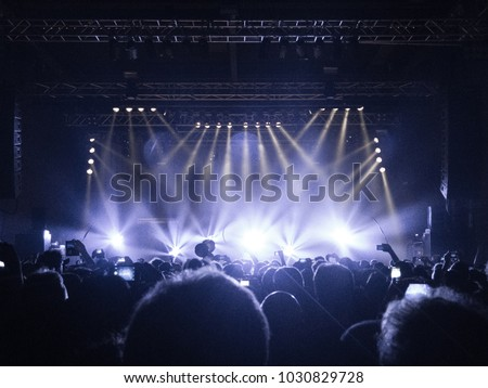 Concert hall with people clapping