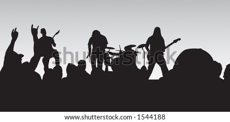 Concert silhouette with crowd cheering and rocking out.