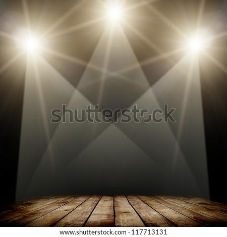 concert spot lighting over dark background and wood floor