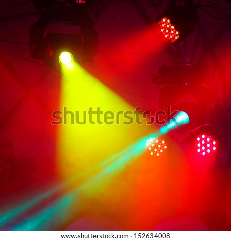concert stage with colors spot light and smoke