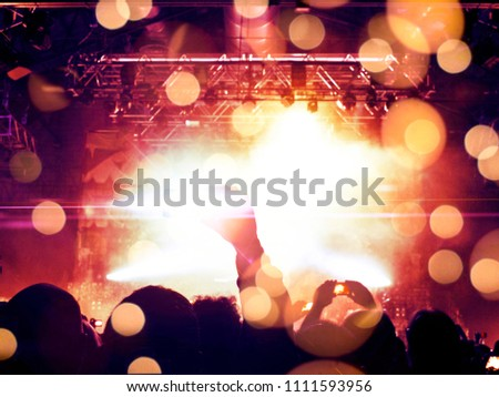 Concert venue crowded with fans, raised hands are visible #1111593956