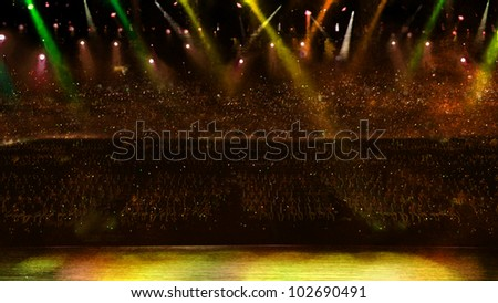 concert with yellow spotlight
