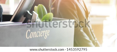 Concierge service desk counter with staff team working in front of hotel with tourist business customer reception.  Stock photo ©