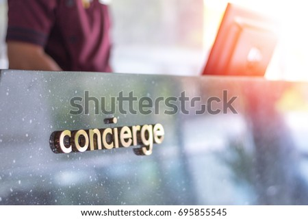 Concierge service desk counter with staff team working in front of hotel with tourist business customer. Stock photo ©