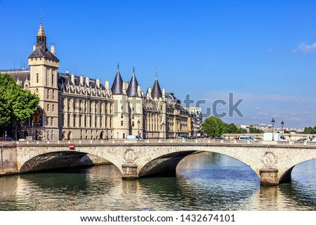 Conciergerie Castle and Bridge of Change (Pont au Change) over river Seine. Castle Conciergerie is a former prison, located on west of the Cite Island and today it is a part of Palais de Justice.  Photo stock ©