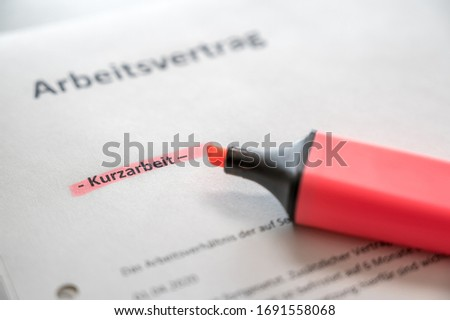 Conclusion of an employment contract in short-time work with the words employment contract and short-time work in german language Сток-фото ©