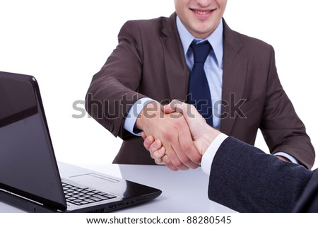 Conclusion of job interview - two young men shaking hands