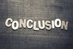 Conclusion word  by wood letters on wood background