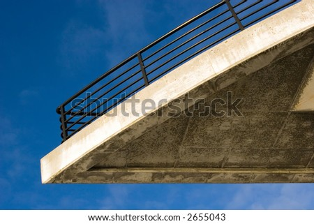Concrete balcony against a blue sky