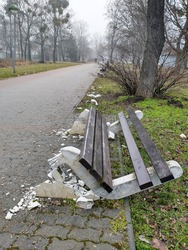 concrete bench broken by vandals in public park
