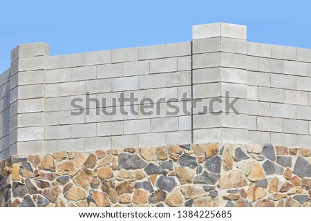 Concrete block bricks in stack for wall construction. Concrete block, cinder blocks, breeze blocks, hollow blocks, Besser blocks or Besser bricks wall background, brick texture #1384225685