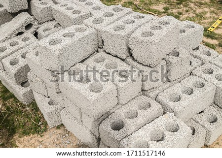 Concrete block bricks in stack for wall construction. Concrete block, cinder blocks, breeze blocks, hollow blocks, Besser blocks or Besser bricks wall background, brick texture