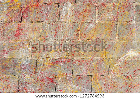 Concrete block wall background and texture.Colorful Concrete block wall as background,color painting on concrete  block  wall .Dropping acrylic paint on the concrete wall.Street art - graffiti.