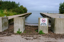 Concrete blocks prevent a slipway being used